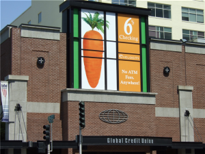 Window wrap in Downtown Spokane, cover your windows with advertising, permanent or temporary, fast signs spokane