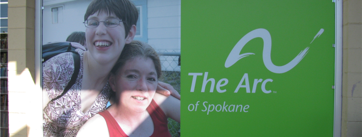 Help your non-profit get the message out like The Arc of Spokane with a custom window sign
