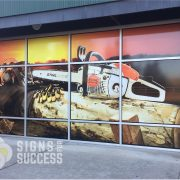 Stihl Chain Saw Graphic on Commercial Windows at Ace Hardware