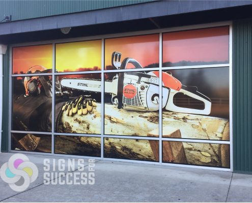 Stihl Chain Saw Graphic on Commercial Windows at Ace Hardware, window graphics