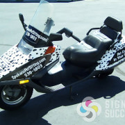 Spokane Pet Sitting asked us to make their scooter look like a Dalmation, with a custom wrap in Spokane, all eyes are on them