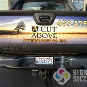 Wrap the tailgate of your pickup so traffic can see your message with tons of views, no permit required