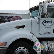 Signs for Success designed a contemporary logo for IEDS and printed and cut vinyl for each semi truck in Spokane Valley