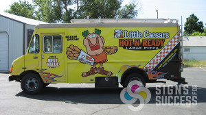 Signs for Success can wrap your food truck in Spokane like this one for Little Caesars van wraps