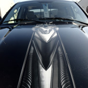 This digitally printed, custom, chrome bed band was installed on a hood of a Dodge and it looks great, decal installation