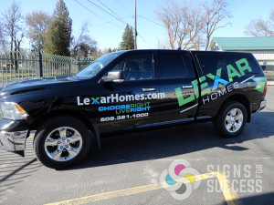 Lexar Homes with MDI Advertising designed and wrapped this pickup with a strong advertising message for this pickup wrap at Signs for Success in Spokane.