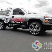 Get the look of a full wrap with a wide band wrapped around sides and tailgate, custom graphics designed at Signs for Success in Spokane and Spokane Valley