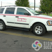 Simple text and striping with reflective and high performance colored striping help this vehicle to stand out in Spokane County