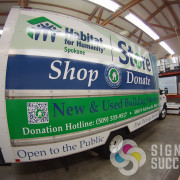 Habitat for Humanity in Spokane needed a custom wrap on their delivery box truck in Spokane Valley, custom van wrap