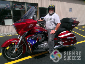 We custom designed this American Flag partial wrap for this red motorcycle in North Spokane, WA
