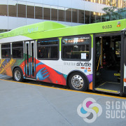 We can wrap a bus, with or without covering the windows with perforated vinyl, Certified wrap installers