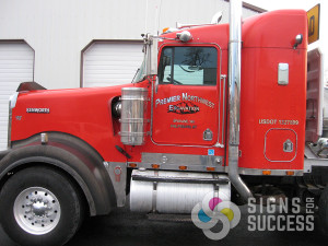 Adding chrome 5 year foil vinyl to a red truck with black accents is a great look for a semi logo, semi truck lettering