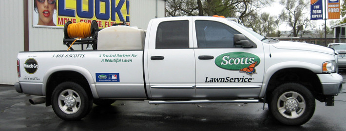 Attractive truck lettering by Signs for Success on clear wrap film for Scott's Lawn Service in Spokane
