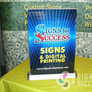 Signs for Success in Spokane uses this retractable desktop display at tradeshows and in our showroom