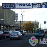 Show community pride and give credit to your sponsors with a banner that spans the street in Hillyard and Spokane Valley