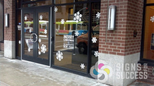 Adding seasonal snowflakes cut from temporary vinyl was a cool message from Global Credit Union to Downtown Spokane pedestrians, window decals spokane