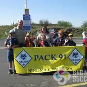 From simple to ornate, a parade banner, like this one for Cub Scout Pack 91 in Nine Mile Falls, makes them proud