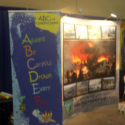 This trade show booth shows retractable banner stand to give information to kids, and the backdrop display to show real life photos to the adults Spokane