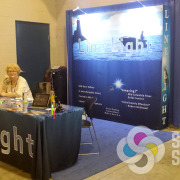 With a matching tablecloth table cover, Line Light in Spokane also added a popup display for an attractive trade show booth