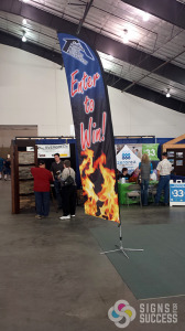 This feather banner for SHBA at Spokane tradeshow stands out and brings the attention, Feather Flags in Spokane