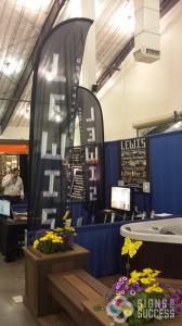 Lewis Construction wanted to stand above the crowd, and you can see them clear across the room with these feather banners by Signs for Success