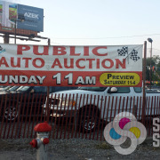 Banner for Cliff's Auto Auction is reused every month, made fast by Signs for Success