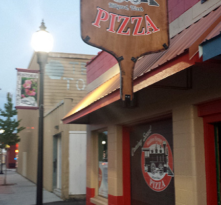 Station House Pizza has the best Pizza in Hillyard, Spokane, and the best sign, with a custom printed HUGE pizza paddle with their logo printed right on both sides