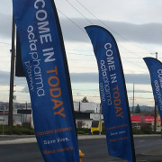 OctaPharma Plasma center in Spokane uses these feather style banners for great advertising by Signs for Success
