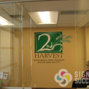 Add your logo to the boardroom wall or to the glass doors leading in, by Signs for Success Spokane