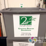 2nd Harvest handles these tubs roughly and wanted a sticker decal that would really grip, so we used an intermediate vinyl label product that has a very high tac adhesive, Signs for Success in Spokane, vinyl signs spokane