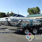 This customer brought in a grunge designed helmet and asked us to match the flavor of it, we succeeded past what he expected with this custom design grunge boat wrap design in Spokane