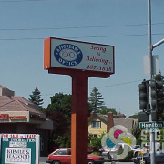 A simple logo can still be SEEN, like this backlit pole sign face for Affordable Optics in Spokane by Signs for Success