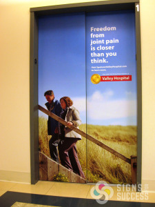 Adding your message or advertisement to the Doors of the Elevator really add impact to your message, Like this at Spokane Valley Hospital installed for Allegra Signs, elevator wraps spokane