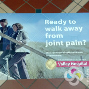 Advertise on the floor with vinyl that contours to the tile, like these at Spokane Valley Hospital for Allegra