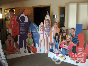 YMCA used these and other life sized kid cutouts for an ad campaign at their clubs around Spokane, they are free standing and cut around the people, non-profit signs
