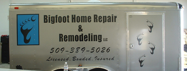 Cut black and blue graphics and lettring on a silver trailer for Bigfoot Home Repair & Remodeling in Spokane and Liberty Lake