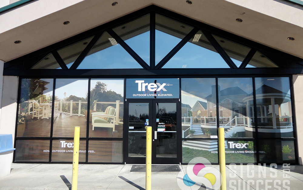 Advertising Trex decking materials, County Homes Building Supply, Spokane used Signs for Success to add perforated window film to wrap their front windows, looks great, environmental window graphics