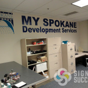 City of Spokane My Spokane Development Services logo on wall for added impact and signage without taking up space, cover bare wall with messages or logo