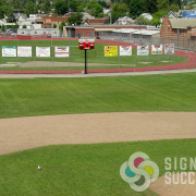 Sports Teams earn extra money by showing sponsor advertising on the Gym wall or on the fences, done fast in Spokane by Signs for Success, outdoor banners Mead