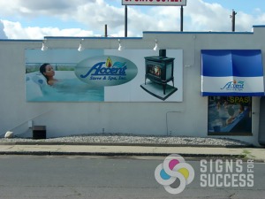 Accent Stove & Spa in Spokane wanted a changeable billboard style sign that they could change seasonally, this coro sign has been up many years, and is for summer on the reverse side, coro billboard sign