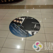 Spokane's Riverpark Square can help advertise for their tenants using floor space, Specialized floor decals can be square or shape cut, custom digitally printed decals with special laminate