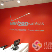 Verizon Wireless has brushed silver foil logo on their wall, it looks great with bright colored paint, looks like metal at a fraction of the cost, Signs for Success installed, Spokane