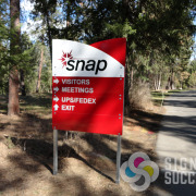 Snap in Spokane wanted a rugged but unique post directional sign, Signs for Success delivered fast and on budget