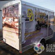 Dynamic Decks put their vendor logos on this for help with defraying advertising costs, Signs for Success designed with different images on all sides in Spokane