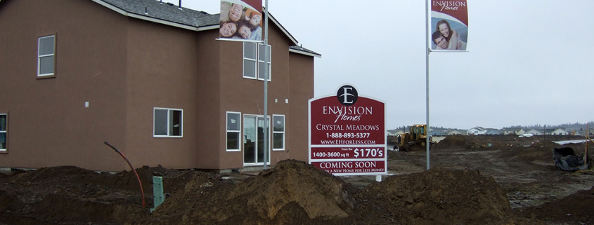 Construction Builders can use site signs and pole banners like Envision Homes in Airway Heights does