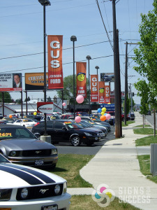 Make an impact with pole banners Spokane like Gus Johnson Ford did now with Signs for Success and the Quinn Group