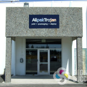 Allpak sign on the concrete wall above their door lets vendors, customers, employees find them more easily, consistent signage is key for vehicle, wall, building, promotional products