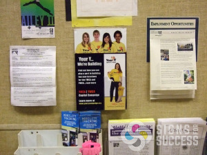 This foam core poster on the bulletin board at Spokane YMCA's has a brochure holder added so people can take info with them, foam board printing