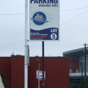 Hard sign in frame on post for Riverfront Park Parking lots downtown Spokane, done fast by Signs for Success