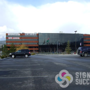 Worthy has Square Feet! large banners on Spokane Valley Building by Signs for Success in Spokane and Greenacres